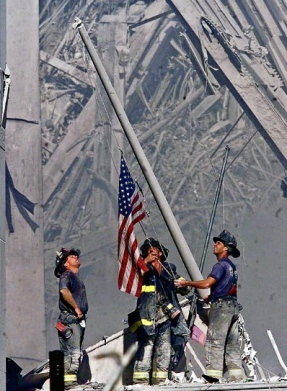 ** PREMIUM CONTENT-SPECIAL RATES APPLY. CALL FOR RATES ** Brooklyn firefighters George Johnson, left, of ladder 157, Dan McWilliams, center, of ladder 157, and Billy Eisengrein, right, of Rescue 2, raise a flag at the World Trade Center in New York, in this Sept. 11, 2001 file photo, as work at the site continues after hijackers crashed two airliners into the center. In the most devastating terrorist onslaught ever waged against the United States, knife-wielding hijackers crashed two airliners into the World Trade Center, toppling its twin 110-story towers. This year will mark the tenth anniversary of the attacks. (AP Photo/Thomas E. Franklin/The Record (Bergen Co. NJ)) MANDATORY CREDIT